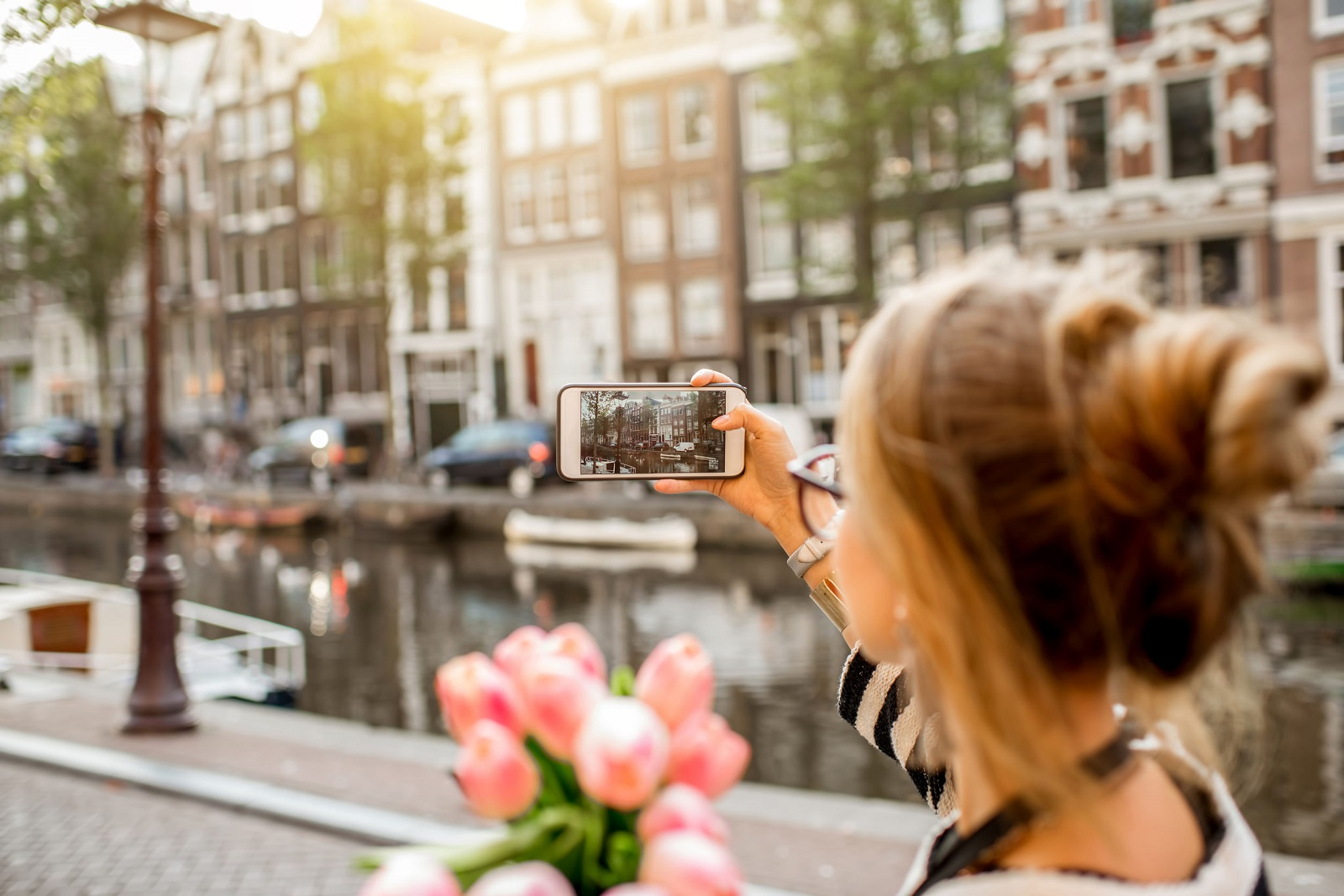 Woman in Amsterdam taking photo